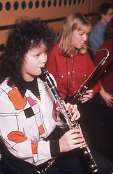 Secondary school pupils playing in school orchestra,
