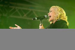 © Licensed to London News Pictures. 24/10/2012. LONDON, UK. Singer Pixie Lott is seen performing at the launch of the Royal British Legion's 2012 Poppy Appeal in Trafalgar Square, London, today (24/10/12).  Photo credit: Matt Cetti-Roberts/LNP
