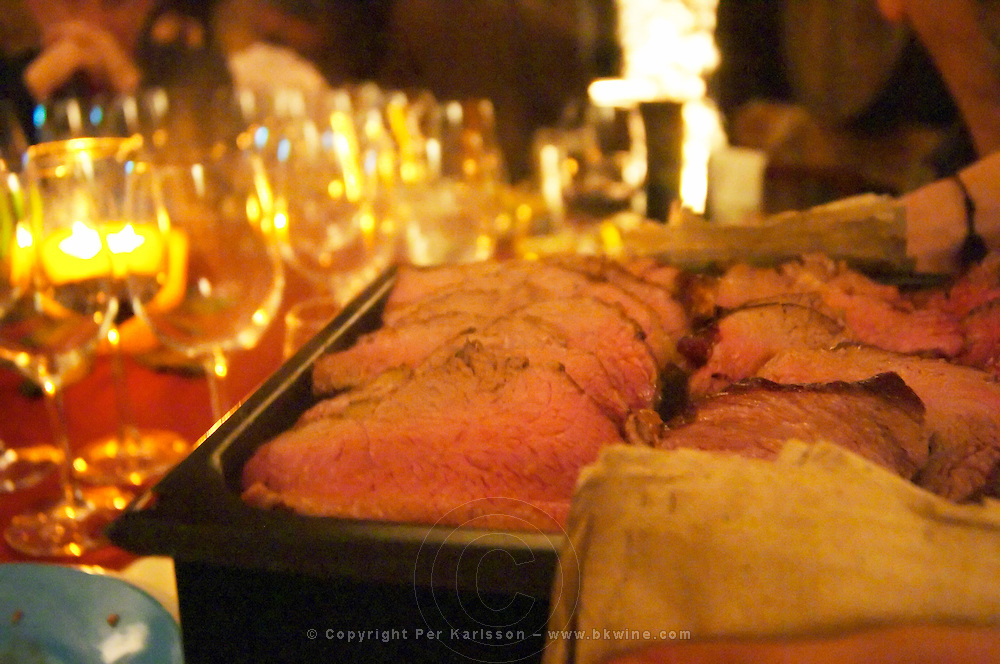 A large plate of traditional charcoal grilled beef being served at the tasting table. Bodega Juanico Familia Deicas Winery, Juanico, Canelones, Uruguay, South America