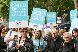 © Licensed to London News Pictures. 18/06/2019. London, UK. Campaigners from Safe Passage and recently arrived young refugees demonstrate in Parliament Square, calling on the Government to welcome 10,000 child refugees. Lord Dubs arrived in the UK on the Kindertransport as a child refugee, along with nearly 10,000 predominantly Jewish children who were fleeing Nazi controlled Europe. Photo credit: Dinendra Haria/LNP