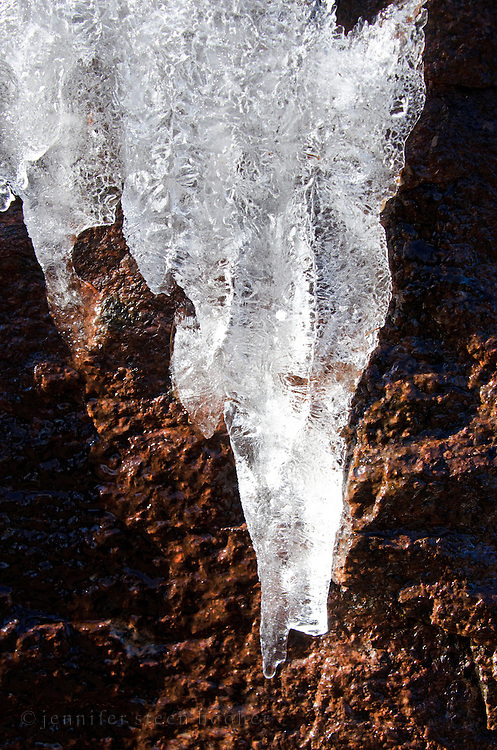 Icicles forming on a pink granite cliff, Acadia National Park, Maine.