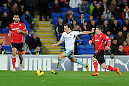West Ham's Mark Noble © shoots and scores his sides 2nd goal. Barclays Premier league, Cardiff city v West Ham Utd match at the Cardiff city Stadium in Cardiff, South Wales on Saturday 11th Jan 2014.<br /> pic by Andrew Orchard, Andrew Orchard sports photography.