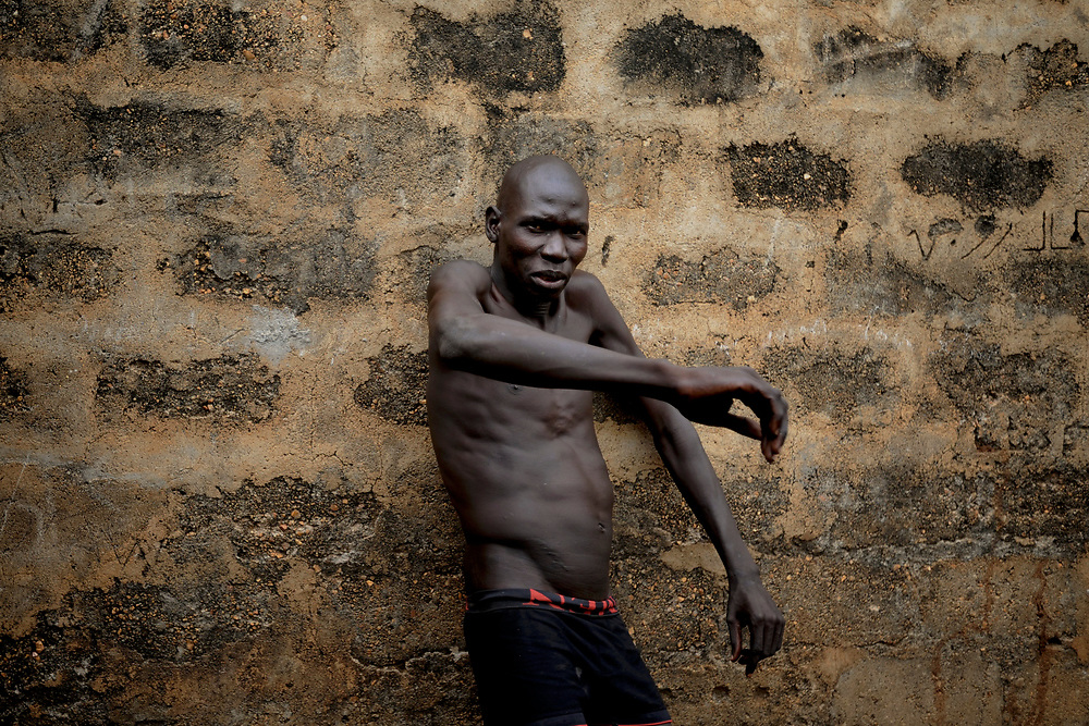 An inmate with a mental condition, at the yard area in Juba Central Prison.