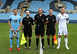 Referee Darren Handley with Coventry City captain Michael Doyle (left) and Boreham Wood captain Mark Ricketts