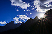 Sun star over the Teton Range, Grand Teton National Park, Wyoming USA