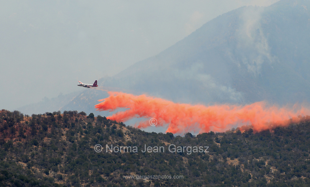 Slurry is being applied in an attempt to contain the Monument Fire in Sierra Vista, Arizona, USA.