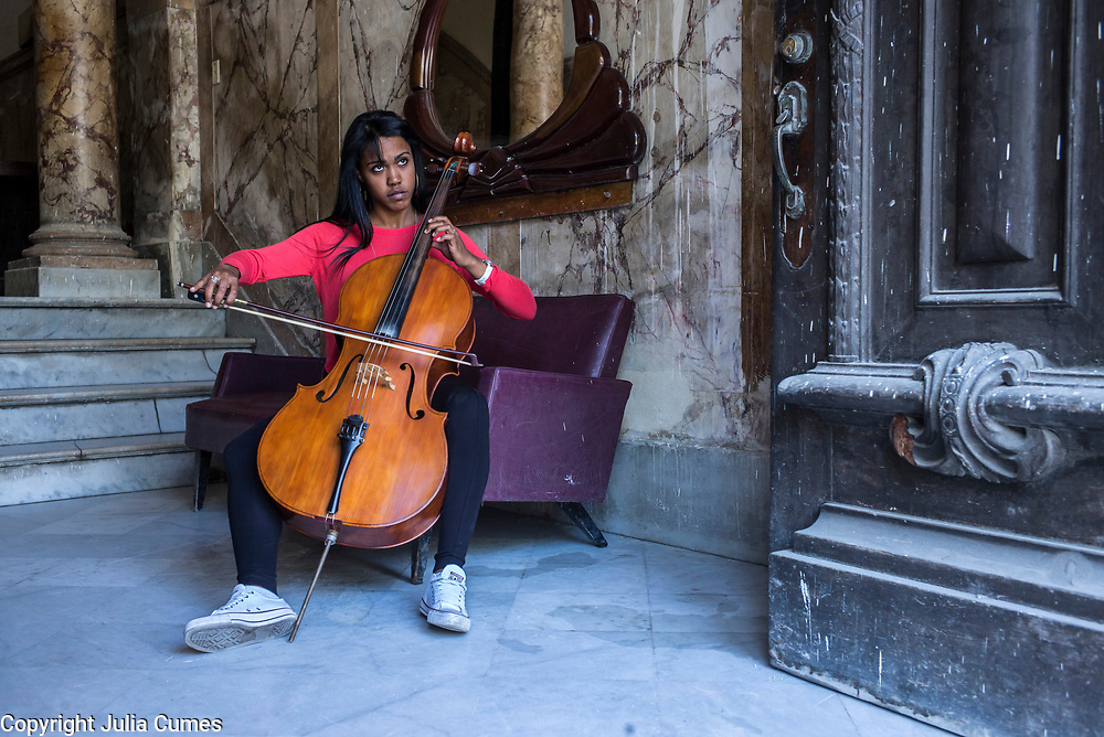 """Grether Ballaga Perez, 25, plays the cello for the orchestra of the Grand Havana Theater of Cuba. She studied music at the prestigious """"Instituto Superior de Arte"""" and dreams of playing for an orchestra outside of Cuba. """"The hardest thing in my life was when my father disappeared when I was 15 year old. Everything in my life changed after that and we still don't know where he is. He worked on a cargo ship so we think maybe he's in Europe with another family."""" Of Cuban women, she says """"a Cuban woman can become what she wants to be in this culture. I believe we have the same rights as men and are prepared to face any system, any society."""""""