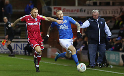Marcus Maddison of Peterborough United in action with Barry Fuller of Gillingham - Mandatory by-line: Joe Dent/JMP - 11/01/2020 - FOOTBALL - Weston Homes Stadium - Peterborough, England - Peterborough United v Gillingham - Sky Bet League One