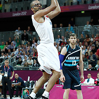 31 July 2012: Tony Parker of France looks to pass the ball during 71-64 Team France victory over Team Argentina, during the men's basketball preliminary, at the Basketball Arena, in London, Great Britain.