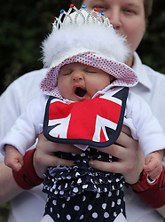 © Licensed to London News Pictures. 04/06/2012. Reading, Berkshire. Lara Hammersley, 11 weeks old, tires at the Shepherds Lane Queen's Diamond Jubileegarden party. Photo credit : Rebecca Mckevitt/LNP
