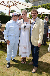 Left to right, SIR JACKIE STEWART, ANNE STEWART and MARK STEWART at the Cartier 'Style et Luxe' part of the Goodwood Festival of Speed, Goodwood House, West Sussex on 14th July 2013.