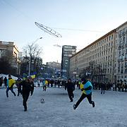 January 29, 2014 - Kiev, Ukraine: Anti-government protestors play football outside Kiev's Independence Square. (Paulo Nunes dos Santos)
