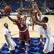 Will Cummings, Temple, drives to the basket past Yanick Moreira, SMU,  during the Temple Vs SMU Semi Final game at the American Athletic Conference Men's College Basketball Championships 2015 at the XL Center, Hartford, Connecticut, USA. 14th March 2015. Photo Tim Clayton