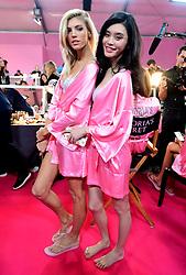 Devon Windsor (left) and Liu Wen backstage at the Victoria's Secret fashion show held at The Grand Palais, Paris, France.