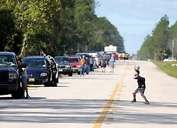 October 8, 2016 - Crescent Beach, Florida, U.S. - TRISTAN CLARKE, 11, who lives on Anastasia Island plays soccer on SR 206 outside of Crescent Beach while waiting in a line of parked cars for access to his home in the beachside community in the aftermath of hurricane Matthew. (Credit Image: © Douglas R. Clifford/Tampa Bay Times via ZUMA Wire)