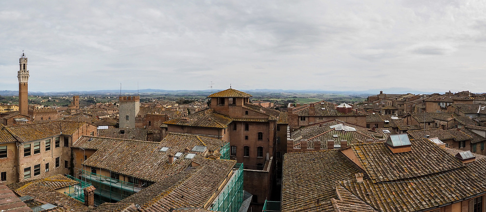 Panoramic view of Siena Town in Tuscany from Panorama dal Facciatone at the Opera Museum by day