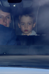 Prince George arriving for the Queen's Christmas lunch at Buckingham Palace, London.