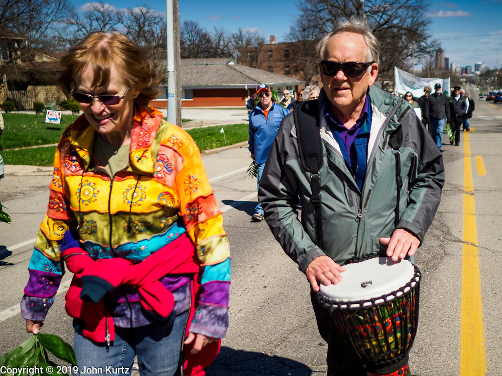 """14 APRIL 2019 - DES MOINES, IOWA: A drummer participates in the Palm Sunday procession for peace in Des Moines. About 200 people participated in an interdenominational  Palm Sunday procession calling for peace. The theme of the procession was """"To Love and Defend our Sacred Earth"""" and it was sponsored by Des Moines Faith Committee for Peace.     PHOTO BY JACK KURTZ"""