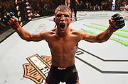 CHICAGO, IL - JULY 25:   TJ Dillashaw reacts after his TKO victory over Renan Barao of Brazil in their UFC bantamweight championship bout during the UFC event at the United Center on July 25, 2015 in Chicago, Illinois. (Photo by Jeff Bottari/Zuffa LLC/Zuffa LLC via Getty Images)