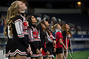 Iraan High School cheerleader Lauren Garlock stands on the sideline during the state championship game at AT&T Stadium in Arlington, Texas on December 15, 2016. (Cooper Neill for The New York Times)