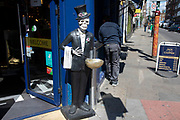 Skeleton outside Jack the Chipper as lockdown continues and people observe the stay at home message in the capital on 12th May 2020 in London, England, United Kingdom. Coronavirus or Covid-19 is a new respiratory illness that has not previously been seen in humans. While much or Europe has been placed into lockdown, the UK government has now announced a slight relaxation of the stringent rules as part of their long term strategy, and in particular social distancing.