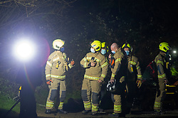 © Licensed to London News Pictures 19/01/2021.        Orpington, UK. A person has been rescued from the River Cray in Orpington,South East London tonight (19.01.21) by The London Ambulance Hazardous Area Response Team along with firefighters from the London Fire Brigade.The condition of the person is unknown. Photo credit:Grant Falvey/LNP