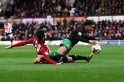 Yoann Barbet of Brentford tackles Bobby Reid of Bristol City in the penalty box - Mandatory by-line: Dougie Allward/JMP - 16/04/2016 - FOOTBALL - Griffin Park - Brentford, England - Brentford v Bristol City - Sky Bet Championship