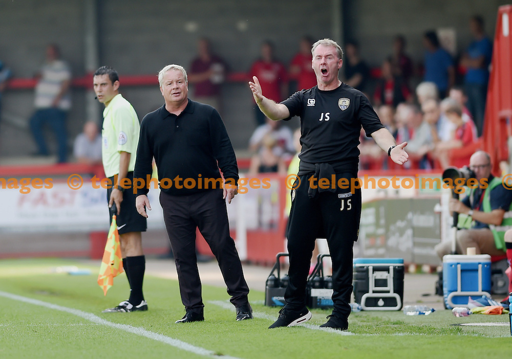 Notts County manager John Sheridan (right) gets heated on the touchline alongside Crawley manager Dermot Drummy during the Sky Bet League 2 match between Crawley Town and Notts County at the Checkatrade Stadium in Crawley. August 27, 2016.<br /> Simon  Dack / Telephoto Images<br /> +44 7967 642437