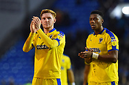 Alfie Egan (28) of AFC Wimbledon and Paul Kalambayi (30) of AFC Wimbledon applauds the travelling fans at full time after a 2-1 loss to Portsmouth during the EFL Sky Bet League 1 match between Portsmouth and AFC Wimbledon at Fratton Park, Portsmouth, England on 1 January 2019.