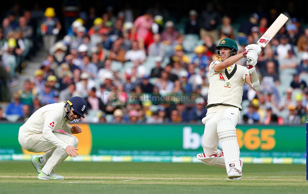 Australia's Pat Cummins hits a shot as Mark Stoneman ducks for cover during day two of the Ashes Test match at the Adelaide Oval, Adelaide.