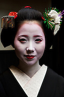 "Apprentice geisha are called maiko literally ""dance child"". It is the maiko, with her white make-up and elaborate kimono and hairstyle, that has become the stereotype of a geisha to Westerners. Geiko as they are called in Kyoto (Geisha elsewhere in Japan) are traditional, female Japanese entertainers whose skills include performing various Japanese arts such as classical music and dance."