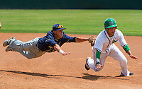Elk Grove Thundering Herd's Carlos Moseley (5), makes the final out of the game as he tags out St. Mary's Ram's Ramil Pinzon (35), to win 5-2 in the Sac-Joaquin Section Division I championship baseball game at Sacramento City College, Saturday May 30, 2015. Elk Grove swept the best of three games series in two games.<br /> Brian Baer/Special to the Bee