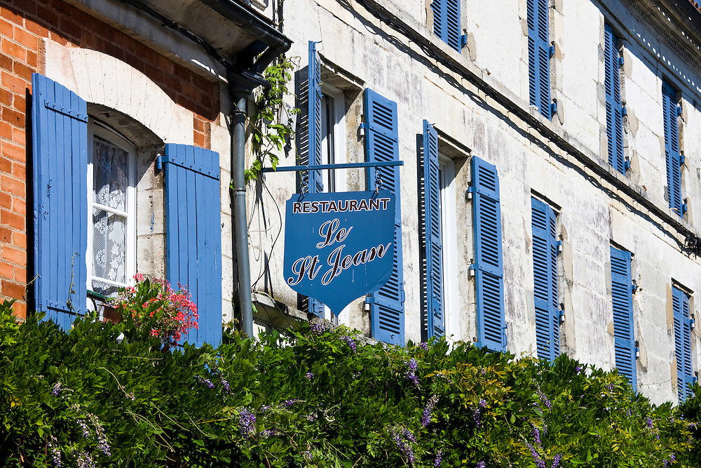 Restaurant Le St Jean, typical French restaurant with blue window shutters and sign in St Jean de Cole, The Dordogne, France
