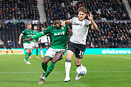 Chris Martin (19) & Moses Odubajo (22) challenge for the ball during the EFL Sky Bet Championship match between Derby County and Sheffield Wednesday at the Pride Park, Derby, England on 11 December 2019.