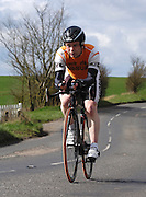 United Kingdom, Finchingfield, Mar 27, 2010:  Simon Daw, CC Sudbury, approaches the 4 miles to go marker during the 2010 edition of the 'Jim Perrin' Memorial Hardriders 25.5 mile Sporting TT promoted by Chelmer Cycling Club. Copyright 2010 Peter Horrell.