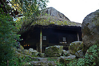 """The dukligan or fertility hut is the most interesting building at Tam Awan village.  In traditional Ifugao practice mating couples stay there for a month. If the woman fails to conceive within that period, the man is allowed to sleep with another woman without forfeiting the marriage. The same treatment applies to the woman.  She can sleep with another man to find out which of them is fertile. Tam-awan Village is a model Cordillera village and a center of local arts and culture in Baguio. The name Tam-awan is from an indigenous word meaning """"vantage point"""".  Tam Awan was established by Benedicto Cabrera also known as Bencab in order to promote the local arts scene. The village consists of authentic Ifugao and Kalinga huts on hilly terrain."""