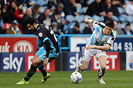 Joe Lolley of Huddersfield Town (r) goes past Alex Lopez of Sheffield Wednesday. Skybet football league Championship match, Huddersfield Town v Sheffield Wednesday at the John Smith's Stadium in Huddersfield, Yorkshire on Saturday 2nd April 2016.<br /> pic by Chris Stading, Andrew Orchard sports photography.