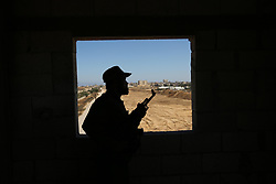 June 29, 2017 - Rafah, Gaza Strip, Palestinian Territory - A member of Palestinian security forces stands guard during patrol a section of the border with Egypt, in the southern Gaza strip town of Rafah. The buffer zone is expected to extend for a length of 12 kilometres and at a width of 100 metres along the border, with a road and security cameras running parallel, according to a statement by a security official. (Credit Image: © Ashraf Amra/APA Images via ZUMA Wire)