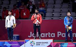 JAKARTA, Aug. 19, 2018  Bajrang Bajrang (C) of India, Takatani Daichi(L) of Japan and Sirojiddin Khasanov of Uzbekistan during Men's Wrestling Freestyle 65 kg awarding ceremony at the 18th Asian Games at Jakarta, Indonesia, Aug. 19, 2018. (Credit Image: © Yue Yuewei/Xinhua via ZUMA Wire)