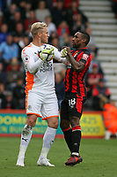 Football - 2017 / 2018 Premier League - AFC Bournemouth vs. Leicester City<br /> <br /> Kasper Schmeichel of Leicester City and Bournemouth's Jermain Defoe clash as the keeper collects the ball at the Vitality Stadium (Dean Court) Bournemouth<br /> <br /> COLORSPORT/SHAUN BOGGUST