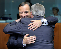 """Franco Frattini, Italy's foreign minister, greets Jean-Claude Juncker, Luxembourg's prime minister, during the European Union Summit at the EU headquarters in Brussels, Belgium, on Thursday, Oct. 29, 2009. European Union leaders are set for """"very difficult"""" talks to overcome the Czech Republic's resistance to a new governing treaty designed to strengthen the EU's influence in world affairs, Reinfeldt said. (Photo © Jock Fistick)"""