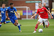 Barnsley's Mike-Steven Bahre (21) takes on Peterborough United defender Ryan Tafazolli (5) during the EFL Sky Bet League 1 match between Peterborough United and Barnsley at The Abax Stadium, Peterborough, England on 6 October 2018.