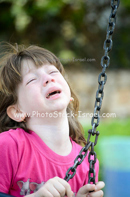 Frustrated Young girl of 6 outdoors