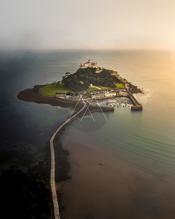 Aerial view of St. Michael castle, a beautiful landmark on Mount St. Michael island in Cornwall, United Kingdom.