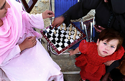 Afghan women playing chess at Bagh-e-Zanan, Kabul...On 23-25 August 2005, Special Olympics Afghanistan held its first national Games at Olympic Stadium in Kabul. More than 300 athletes, including 80 female athletes, experienced a taste of happiness and achievement for the first time in their lives. They competed in athletics, bocce and football (soccer). Because of cultural restrictions, males and females competed at separate venues.