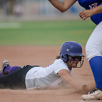 Miyamura Patriot Cassandra Esquivel (17) dives back to first to avoid a pickoff from the West Mesa Mustangs Tuesday at Ford Canyon Park.
