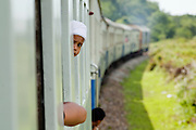 """Sept 26, 2009 -- PATTANI, THAILAND: A Muslim boy rides the train from Pattani to Yala in Thailand. Thailand's three southern most provinces; Yala, Pattani and Narathiwat are often called """"restive"""" and a decades long Muslim insurgency has gained traction recently. Nearly 4,000 people have been killed since 2004. The three southern provinces are under emergency control and there are more than 60,000 Thai military, police and paramilitary militia forces trying to keep the peace battling insurgents who favor car bombs and assassination.  Photo by Jack Kurtz / ZUMA Press"""