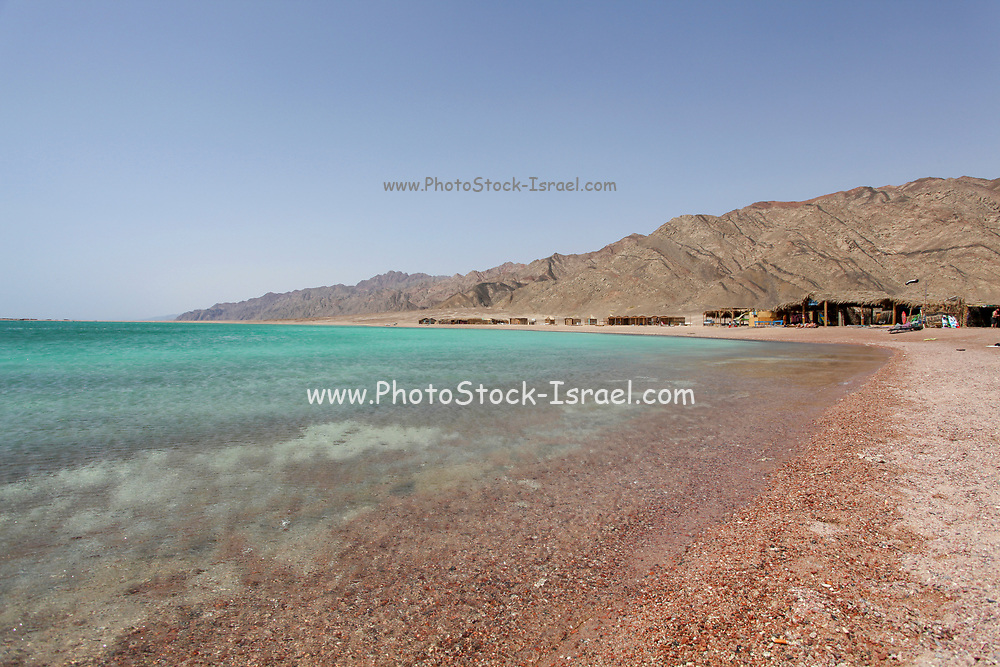 Deserted beaches at the Blue Lagoon (Dahab), Sinai, Egypt Tourist's shanty huts in the background