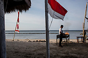 Man barbecues on the beach in Gili Air.