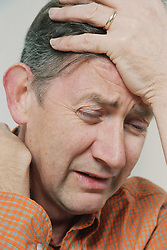Portrait of depressed man looking distressed,